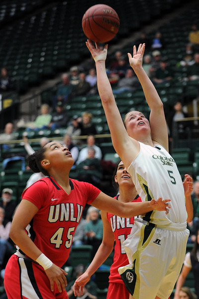 Colorado State senior Kim Mestdagh, right, takes a shot in front of Las Vegas defenders Kelli Thompson, left, and Jamie Smith in the first half of their game Wednesday, Feb. 1, 2012 at Moby Arena.