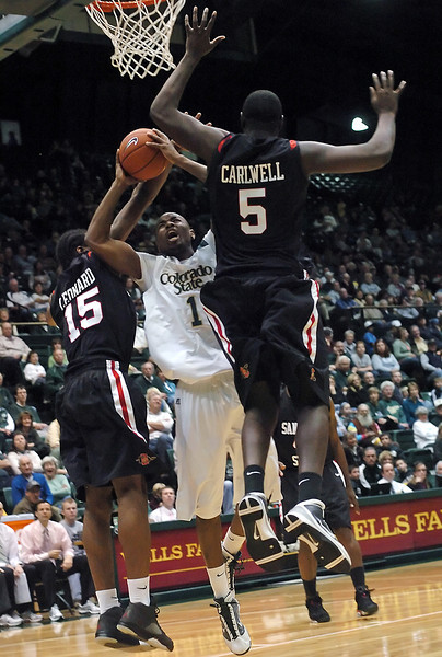 Colorado State University junior Travis Franklin attempts a shot between San Diego State defenders Kawhi Leonard (5) and Brian Barwell (15) in the second half of their game on Saturday, Jan. 30, 2010 at Moby Arena in Fort Collins. The Rams lost, 64-52.