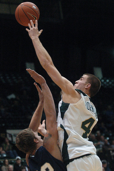 Colorado State University freshman Pierce Hornung takes a shot over Yale's Michael Sands in the second half of their game on Friday, Dec. 31, 2009 at Moby Arena in Fort Collins. Hornung scored 15 points in the Rams 93-71 victory over the Bulldogs.