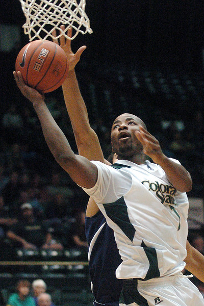 Colorado State University junior Travis Franklin takes a shot in front of Yale's Reggie Wilhite in the second half of their game Friday afternoon at Moby Arena in Fort Collins. Franklin had a team-high 17 points in the Rams' 93-71 victory over the Bulldogs.
