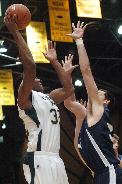 Colorado State University junior Andy Ogide shoots over the outstretched hand of Yale's Paul Nelson in the first half of their game on Friday, Dec. 31, 2009 at Moby Arena in Fort Collins. The Rams won, 93-71.