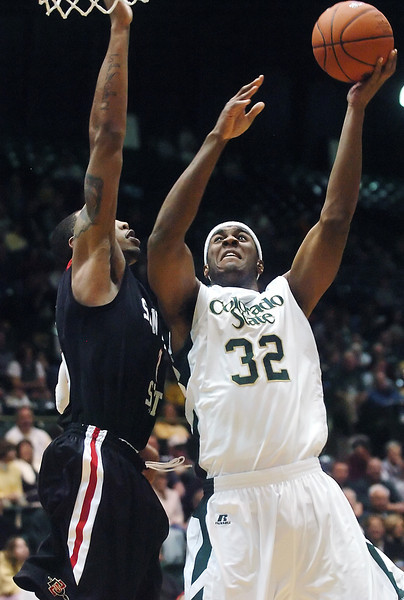 Colorado State University junior Andy Ogide puts up a shot over San Diego State's Malcolm Thomas in the second half of their game on Saturday, Jan. 30, 2010 at Moby Arena in Fort Collins. Ogide led the team with 13 points but the Rams lost to the Aztecs, 64-52.