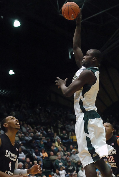 Colorado State University senior Mame Bocar Ba puts up a shot over San Diego State's Malcolm Thomas in the second half of their game on Saturday, Jan. 30, 2010 at Moby Arena in Fort Collins. The Rams lost, 64-52.
