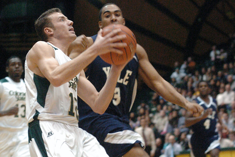Colorado State University junior Adam Nigon drives to the basket ahead of Yale defender Josh Davis in the first half of their game on Friday, Dec. 31, 2009 at Moby Arena in Fort Collins. The Rams won, 93-71.