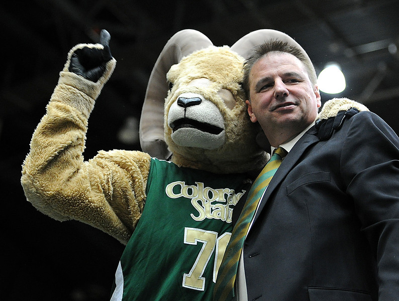 Larry Eustachy, the new head men's basketball coach for Colorado State University, shared a moment with Cam the Ram mascott after being announced at the new coach Thursday afternoon at CSU in Fort Collins.