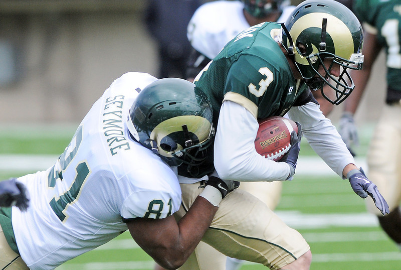 Colorado State University defensive lineman Adam Seymore tackles wide receiver Matt Yemm during the football team's Green and Gold game on Saturday, April 24, 2010 at Hughes Stadiium in Fort Collins.