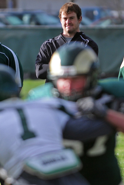 Nick Eaton, a learning coordinator for Colorado State University's football team, watches practice from the sidelines Tuesday morning at the team's on-campus practice field in Fort Collins.