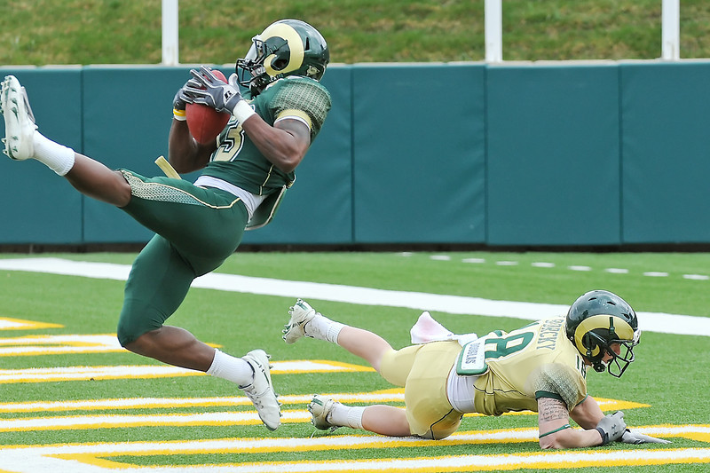 Colorado State University safety Ezra Thompson intercepts a pass in the end zone that was intended for wide receiver Bobby Borky during the Green-Gold game Saturday at Hughes Stadium in Fort Collins.