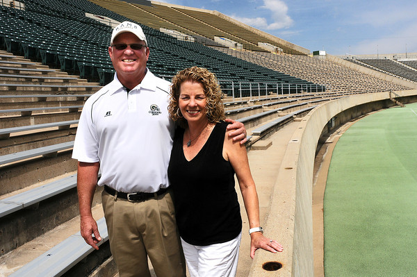 CSU Defensive Coordinator Larry Kerr and his wife Tracy Pose for a photo during media day on Thursday at Hughes Stadium in Fort Collins.