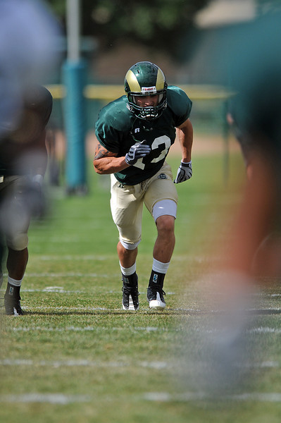 Colorado State University running back Derek Good runs during practice drills on Wednesday at the university. Good is Berthoud High School graduate.