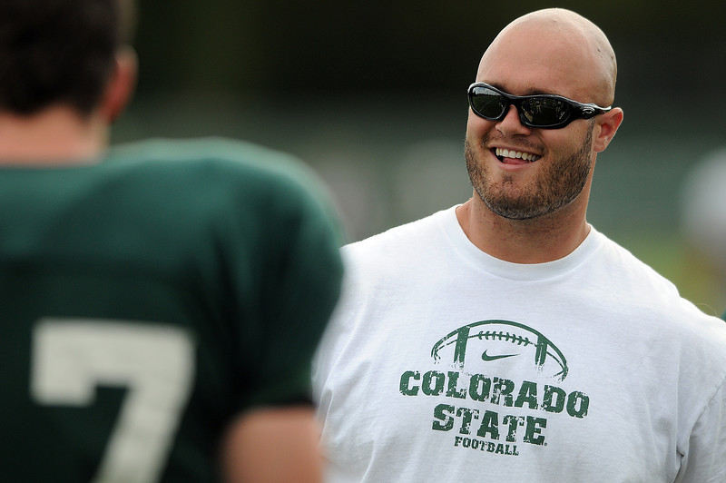 Colorado State University Graduate Coach Trevor Wikre talks with players during practice on Wednesday.