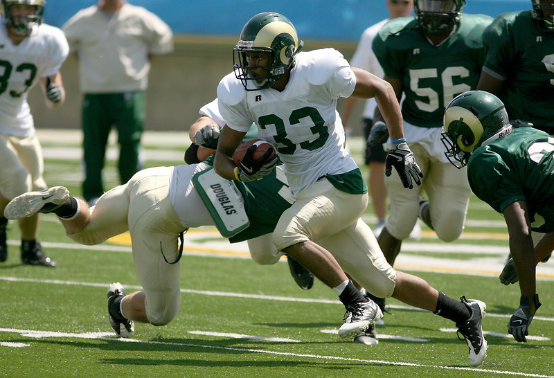 Colorado State University running back, Lou Greenwood, gets around line back, Luke Diehl, during a scrimmage Saturday at Lubick Field at Hughes Stadium in Fort Collins.