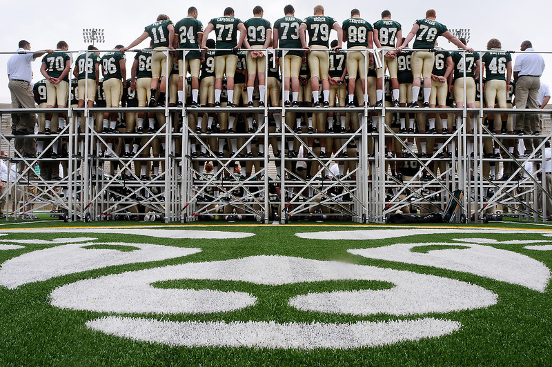 The CSU football team pose for photos during media day on Thursday at Hughes Stadium in Fort Collins.