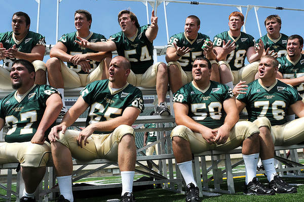 "Members of the CSU football team scream out ""dude"" for a video for an anti-drunken driving campaign for the Colorado Department of Transportation during a media event on Thursday at Hughes Stadium in Fort Collins."