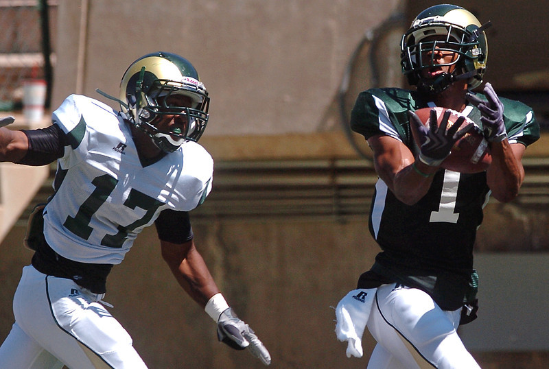 Colorado State University wide receiver Lou Greenwood hauls in a pass for a touchdown ahead of defensive back Dominique Vinson during a situational scrimmage Saturday afternoon at Hughes Stadium in Fort Collins.
