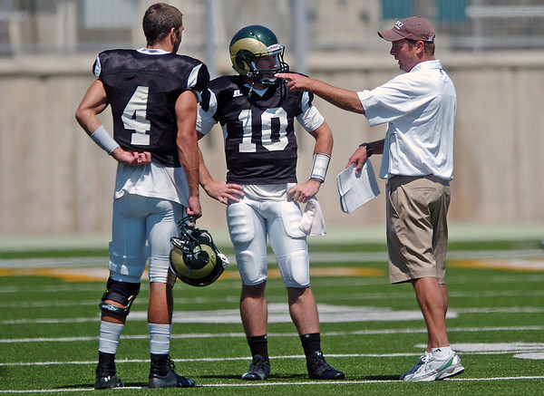 Colorado State University head football coach Steve Fairchild talks to quarterbacks Pete Thomas, left, and Klay Kubiak during a situational scrimmage on Aug. 14, 2010 at Hughes Stadium in Fort Collins.