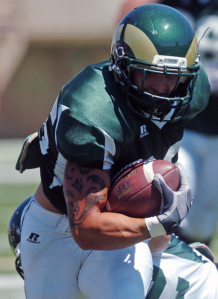 Colorado State University junior Derek Good makes a carry during a situational scrimmage Saturday at Hughes Stadium in Fort Collins.