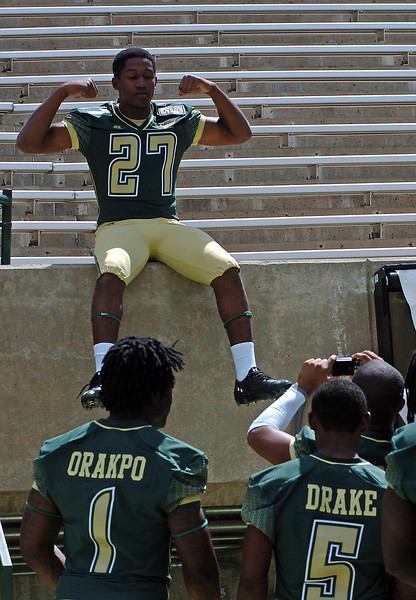 Colorado State University freshman football player Najee James, center, fools around with other freshmen players as he poses for a snapshot Wednesday during media day at Hughes Stadium in Fort Collins.