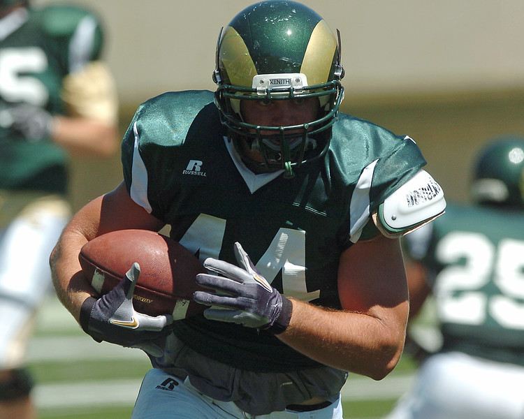 Colorado State University freshman Joe McKay makes a carry during a situational scrimmage Saturday afternoon at Hughes Stadium in Fort Collins.