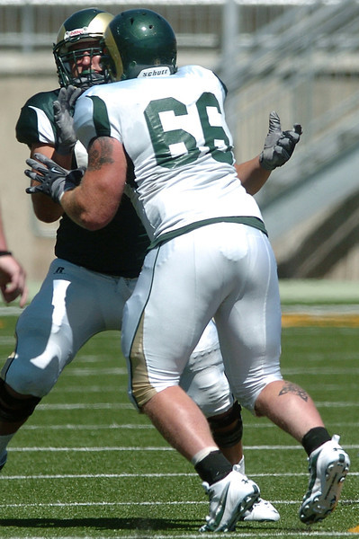 Colorado State University defensive lineman Guy Miller (66) goes up against teammate Jordan Gragert during an August scrimmage at Hughes Stadium.