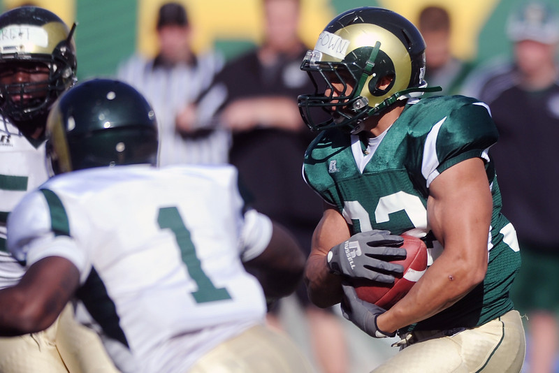 Colorado State running back Dorian Brown, right, makes a carry during an intra-squad scrimmage Saturday, April 7, 2012 at Hughes Stadium.