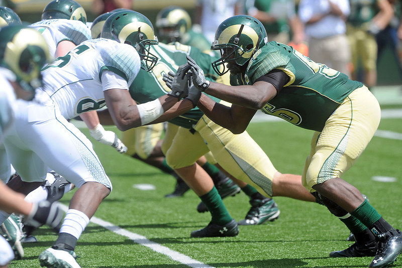 Colorado State linebacker Shaquil Barrett, right, squares off against tight end Kivon Cartwright during the Green-Gold Game on Saturday, April 21, 2012 at Hughes Stadium.