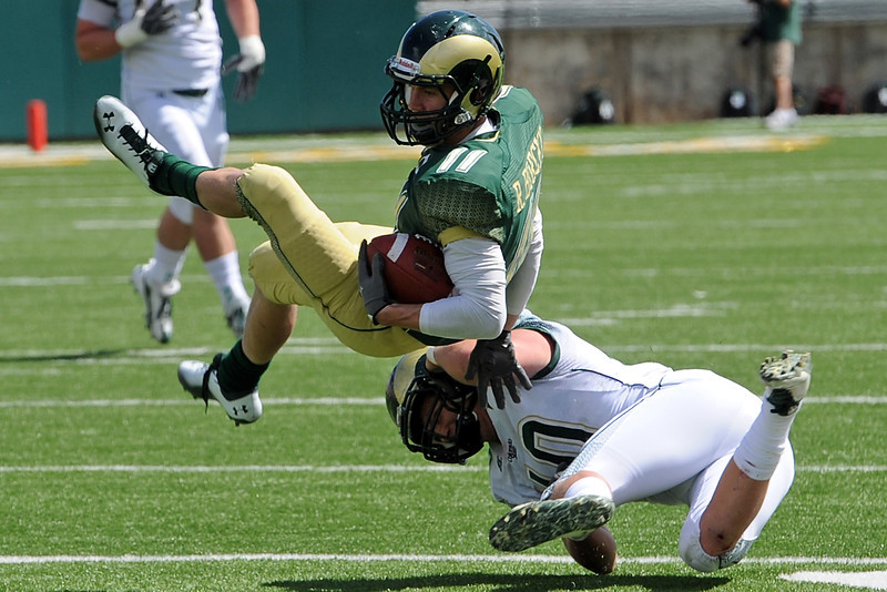 Colorado State wide receiver Bobby Borcky (11) is tackled after a catch by linebacker Max Morgan during the Green-Gold Game on Saturday, April 21, 2012 at Hughes Stadium.