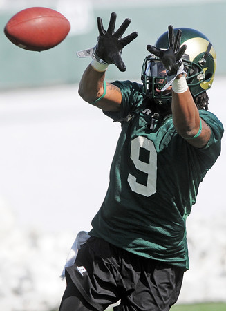 Colorado State University wide receiver Marquise Law makes a catch during the football team's first practice of the spring on Thursday, March 25, 2010 in Fort Collins.