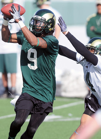 Colorado State University wide receiver Marquise Law makes a catch in front of cornerback Brandon Owens during the football team's first practice of the spring on Thursday, March 25, 2010 in Fort Collins.