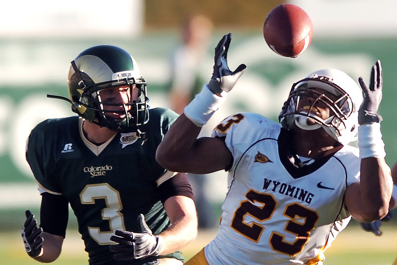 Univesity of Wyoming linebacker Ghaali Muhammad intercepts a pass as Colorado State's Matt Yemm looks on in the fourth quarter of their game on Saturday, Nov. 27, 2009 at Hughes Stadium in Fort Collins. CSU lost, 17-16.