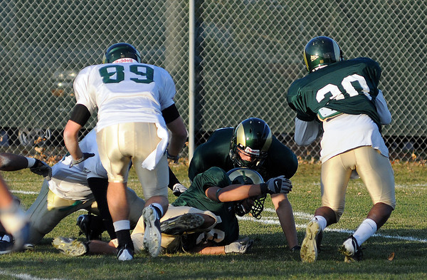 Members of the CSU football team run through plays during practice on Wednesday afternoon in Fort Collins.