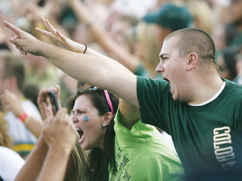 Colorado State fan, Bill Cooper, cheers after CSU scores their second touchdown against CU on Sunday at Folsom Field in Boulder.
