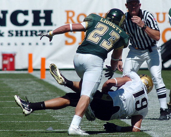 University of Colorado safety Travis Sandersfeld (19) intercepts a pass intended for Colorado State's Tyson Liggett (23) in the second quarter of their game Saturday at Invesco Field in Denver. At first Sandersfeld was ruled out of bounds, but that call was overturned.