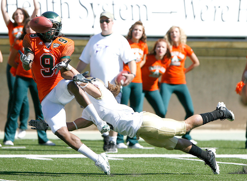 Colorado State's Marquise Law tries to catch a pass new the endzone in the first quarter with Aaron Grymes covering him Saturday at Hughes Stadium. Photo by Gabriel Christus
