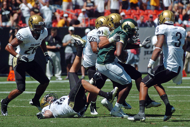 Colorado State University wide receiver Byron Steele is surrounded by Colorado defenders after making a catch in the second quarter of their game Saturday at Invesco Field in Denver.