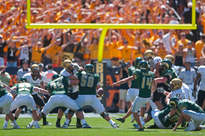 Colorado State University kicker Ben DeLine's kick is blocked at the end of the second quarter of a game against Colorado during the Rocky Mountain Showdown Saturday at Invesco Field in Denver.