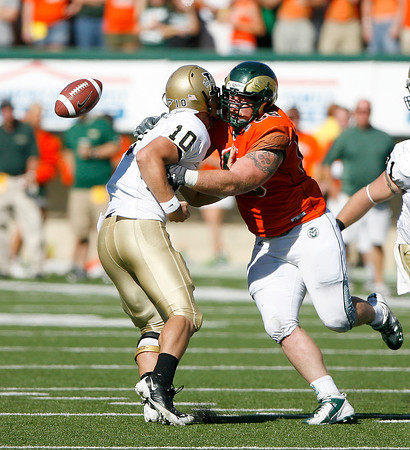 Colorado State's Guy Miller forces a fumble on Idaho's quarterback Nathan Enderle on Saturday at Hughes Stadium. Photo by Gabriel Christus
