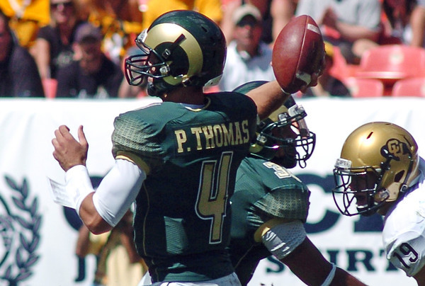 Colorado State University quarterback Pete Thomas throws a pass during a game against Colorado on Saturday at Invesco Field in Denver.