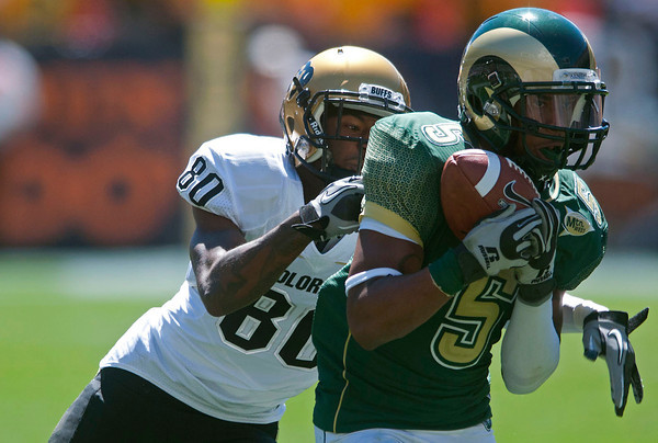 Colorado State University cornerback Momo Thomas intercepts a pass intended for Colorado receiver Will Jefferson in the second quarter of their game Saturday at Invesco Field in Denver.