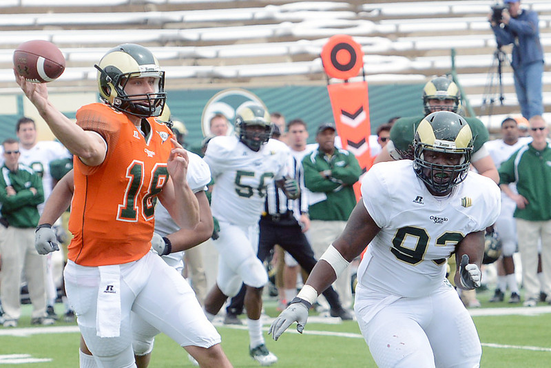 Colorado State University quarterback Garrett Grayson, left, throws a pass while being pursued by defensive lineman Terry Jackson during their scrimmage Saturday, April 20, 2013 at Hughes Stadium in Fort Collins, Colo.
