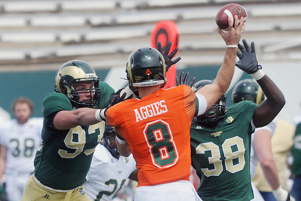 Colorado State University defensive lineman Austin Berk (93) and linebacker Danny Nwosu pressure quarterback Craig Leonard on a pass play in the second half of their scrimmage Saturday, April 20, 2013 at Hughes Stadium in Fort Collins, Colo.