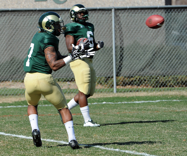 Colorado State University football running backs Donnell Alexander, left, and Chris Nwoke during practice on Wednesday, April 3, 2013 in Fort Collins.