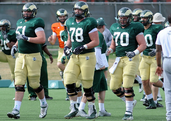 Colorado State University offensive linemen Ty Sambrailo (51), Jared Biard (78) and Weston Richburg (70) run together at the start of practice on Friday, April 5, 2013 at the team's on-campus practice field in Fort Collins, Colo.