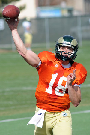 Colorado State University quarterback Garrett Grayson throws a pass during football practice on Friday, April 5, 2013 at the team's on-campus practice field in Fort Collins, Colo.
