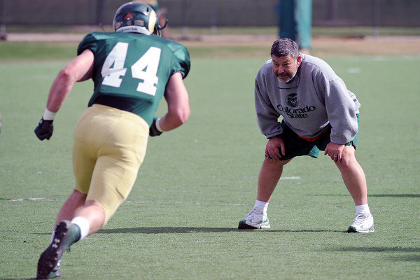 Colorado State University tight ends coach Art Valero looks on while Joe McKay works on a drill during practice Friday, April 5, 2013 at the team's on-campus practice field.