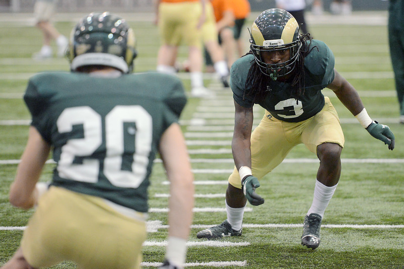 Colorado State University defensive back Shaq Bell, right, lines up against teammate C.J. Glenn while working on a drill together during practice Tuesday, April 16, 2013 at the team's indoor practice facility in Fort Collins, Colo.