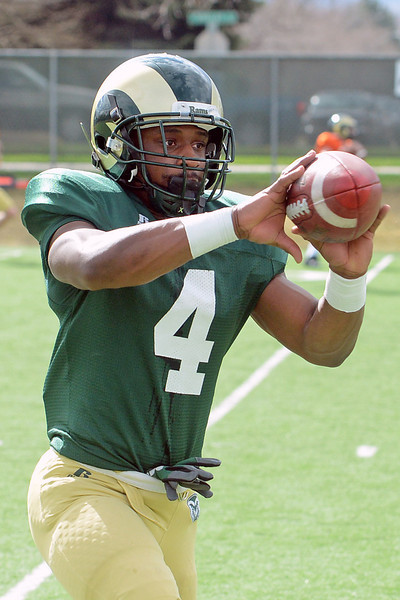 Colorado State University wide receiver Charles Lovett makes a catch during practice Friday, April 5, 2013 at the team's on-campus practice field in Fort Collins, Colo.