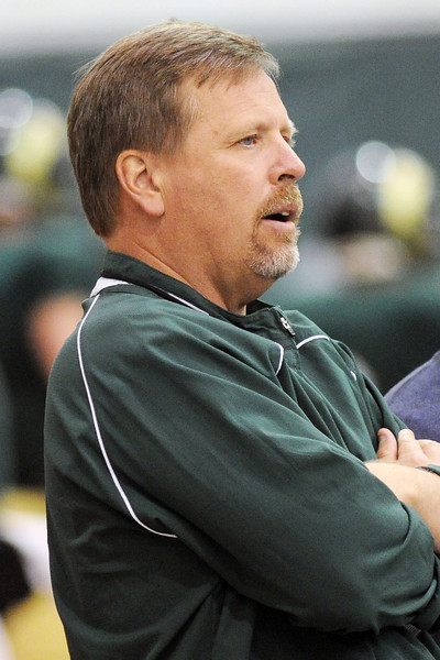 Colorado State University head football coach Jim McElwain looks on during practice Tuesday, April 16, 2013 at the team's indoor practice facility.