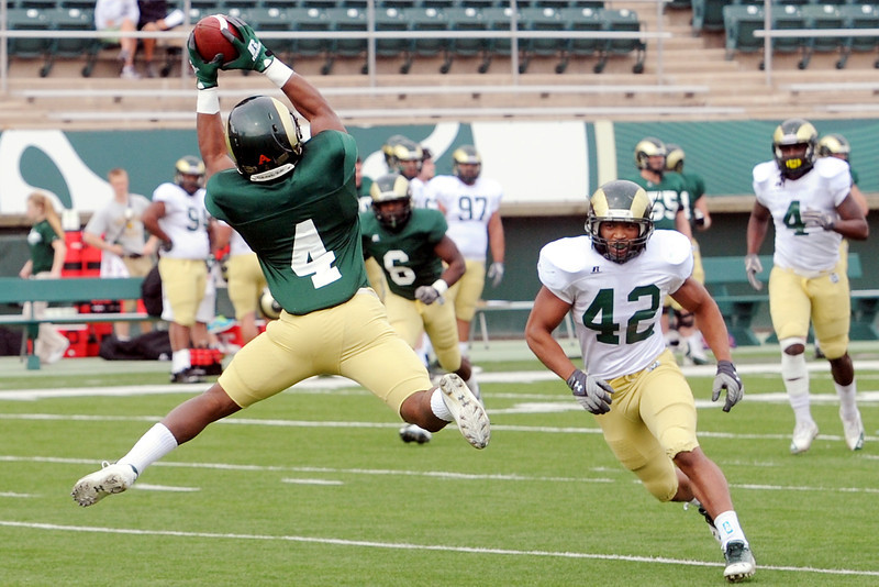 Colorado State University wide receiver Charles Lovett, left, makes a catch in front of linebacker Ken Hulbert (42) while participating in a drill before an intra-squad scrimmage Saturday, April 6, 2013 at Hughes Stadium.