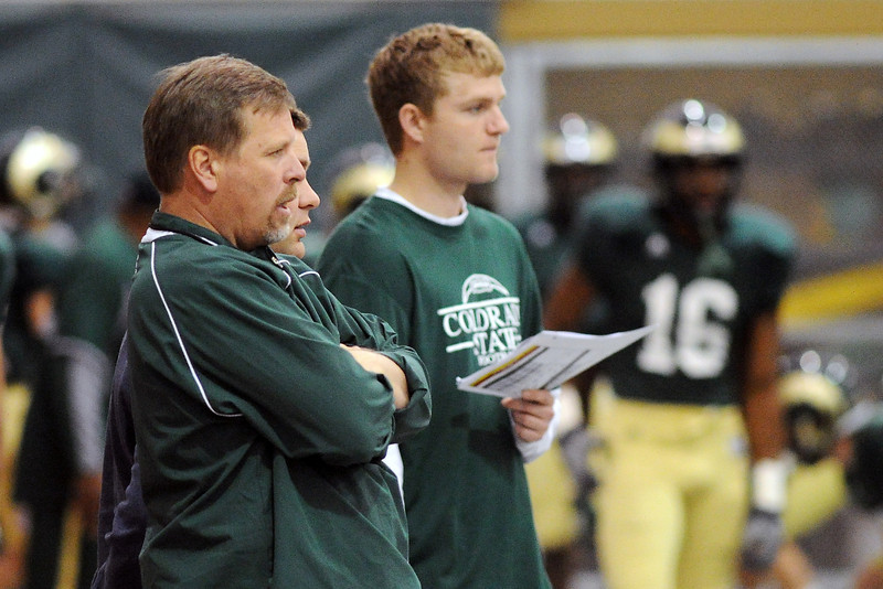 Colorado State University head football coach Jim McElwain, left, looks on during practice Tuesday, April 16, 2013 at the team's indoor practice facility.